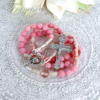 小さなピンクのバラのロザリオ